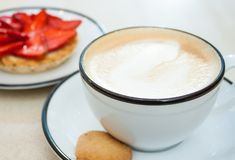 Cappuccino and strawberry tart stock photos