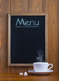 White cup and chalk board Stock Photos