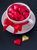 White cup with chocolate hearts Royalty Free Stock Image