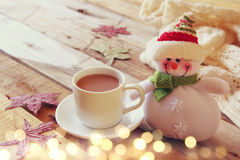 White cup with chocolate, snowman and christmas lights Stock Photography