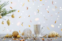 White cup and  christmas decorations stock photo