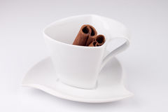 White cup with cinnamon. Very cute white cup with cinnamon in it Stock Images
