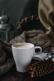 White cup of cocoa on an old wooden table with an entertaining b Royalty Free Stock Photo