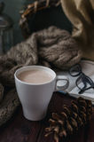 White cup of cocoa on an old wooden table with an entertaining b Stock Photo