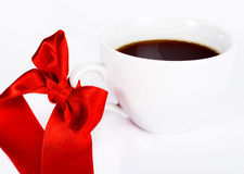 White cup of coffe with red bow Stock Photo