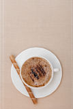 White cup coffe and waffle roll with cream on brown background Stock Photography