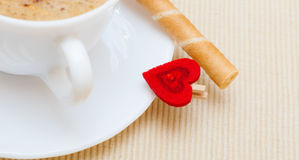 White cup coffe waffle roll with cream heart. Love valentine's day Stock Photos