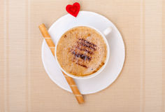 White cup coffe waffle roll with cream heart. Love valentine's day Stock Photo