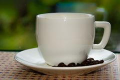 Cup of coffee. White cup of coffee royalty free stock photos