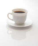 White Cup With Coffee. Reflection from below Stock Images