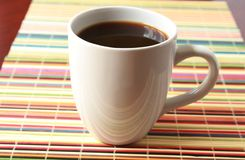 White cup with coffee Stock Photos