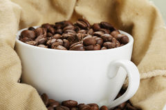 White cup in coffee bag Royalty Free Stock Image
