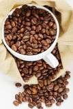 White cup with coffee in bag Stock Photo