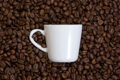 White cup on a coffee beans Royalty Free Stock Image