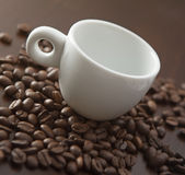 White cup with coffee beans Royalty Free Stock Photo
