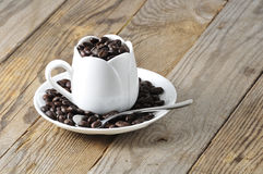 White cup with coffee beans Royalty Free Stock Photography