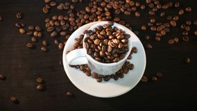 White Cup With Coffee Beans.  Stock Photo