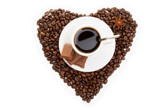 White cup of coffee on  beans as a heart Royalty Free Stock Photos