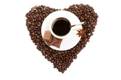 White cup of coffee on  beans as a heart Royalty Free Stock Photo
