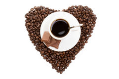 White cup of coffee on  beans as a heart Royalty Free Stock Photography