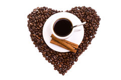 White cup of coffee on  beans as a heart Stock Images
