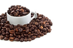 White cup and coffee beans. On white background Stock Image