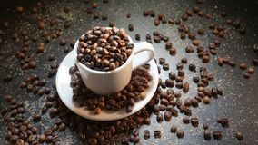 White Cup With Coffee Beans on Black Background.  Stock Photography