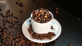 White Cup With Coffee Beans on Black Background.  Royalty Free Stock Photography