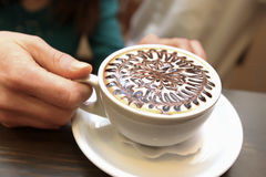 White cup of coffee with beans. On the desk Royalty Free Stock Photos