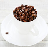 White cup and coffee beans Stock Photos