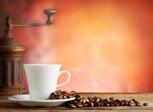 White cup with coffee beans and grinder Stock Photo