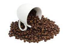 White cup with coffee beans isolated in white Royalty Free Stock Photography