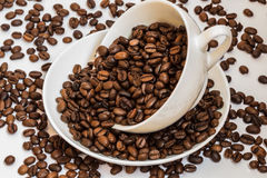 White cup with coffee beans Stock Image