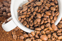 White cup with coffee beans Stock Photography