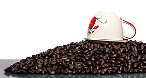 White cup coffee beans Royalty Free Stock Images