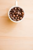 White cup of coffee beans with space for text Stock Photography