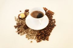 White cup coffee, coffee beans ,  sweet, copy space. Candid. White cup coffee, beans , gold  sweet, copy space. Candid Royalty Free Stock Photo
