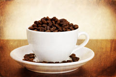 White cup of coffee beans Royalty Free Stock Images