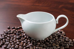 White cup and coffee beans Royalty Free Stock Image