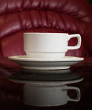 White cup of coffee on Black reflect table Royalty Free Stock Images