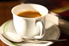 White cup of coffee and book background Stock Photography