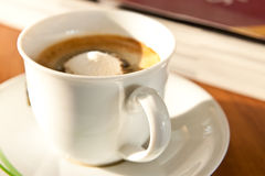 White cup of coffee and book background Royalty Free Stock Photography