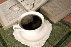 White cup of coffee, books background Stock Image