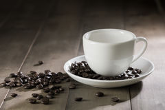 White cup of coffee on brown wood table. Dark tone Stock Photography