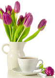 White cup of coffee with bunch of purple tulips  on whit. E Stock Photo