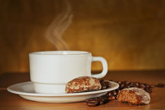 White cup of coffee and cakes on a plate Royalty Free Stock Image
