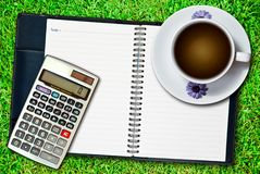 White cup of coffee and calculator Stock Images