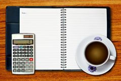 White cup of coffee and calculator Stock Photography