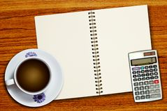 White cup of coffee and calculator Stock Photo