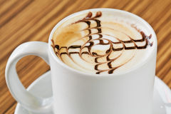 White cup of coffee with chocolate decoration Stock Image